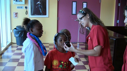 Yendi Valdes from CompUSA showed students at the Overtown Youth Center how to make their own movies with a Flip video camera.